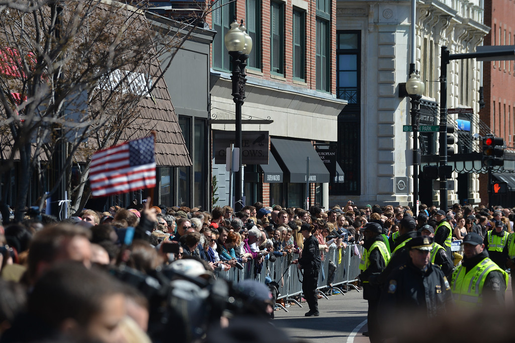 . People gather outside of the Cathedral of the Holy Cross as US President Barrack Obama and wife Michelle attend an interfaith prayer service to honor the victims of the Boston Marathon bombings April 18, 2013 in the South End neighborhood of Boston, Massachusetts.  AFP PHOTO/Stan  HONDA/AFP/Getty Images