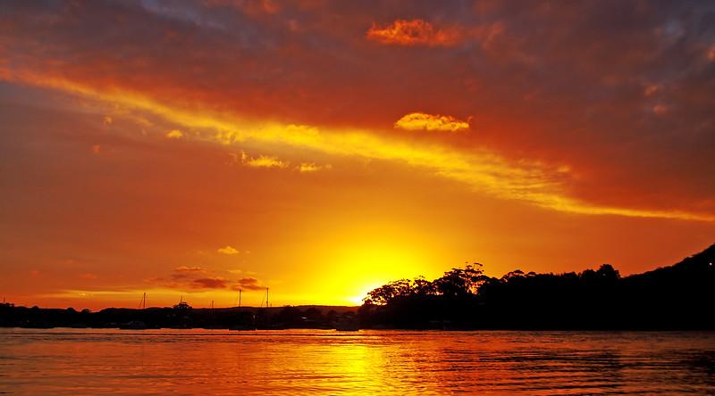 Gold and Orange coloured Nimbostratus cloudy coastal Sunset Seas