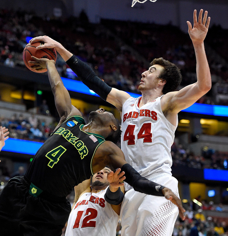 . Baylor guard Gary Franklin (4) has a shot stopped by Wisconsin forward Frank Kaminsky (44) during an NCAA men\'s college basketball tournament regional semifinal, Thursday, March 27, 2014, in Anaheim, Calif. (AP Photo/Mark J. Terrill)