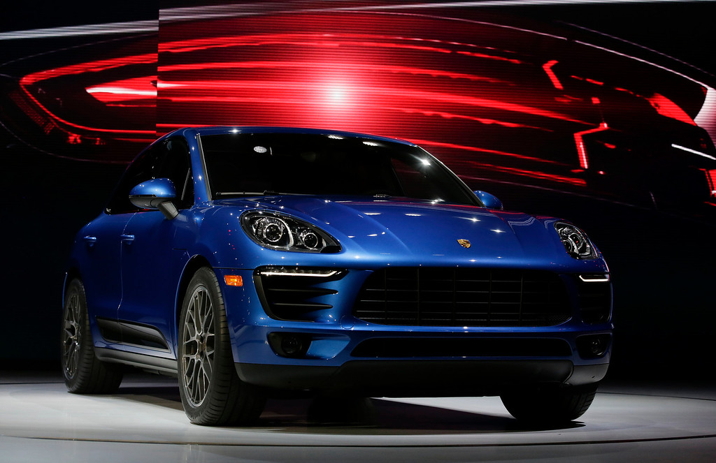. The new Porsche Macan S in introduced at the Los Angeles Auto Show in Los Angeles, Tuesday, Nov. 19, 2013. (AP Photo/Chris Carlson)