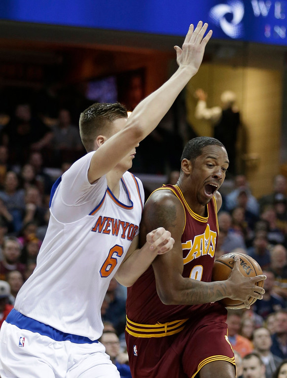 . Cleveland Cavaliers\' Channing Frye (8) drives against New York Knicks\' Kristaps Porzingis (6), from Latvia, in the first half of an NBA basketball game, Thursday, Feb. 23, 2017, in Cleveland. (AP Photo/Tony Dejak)