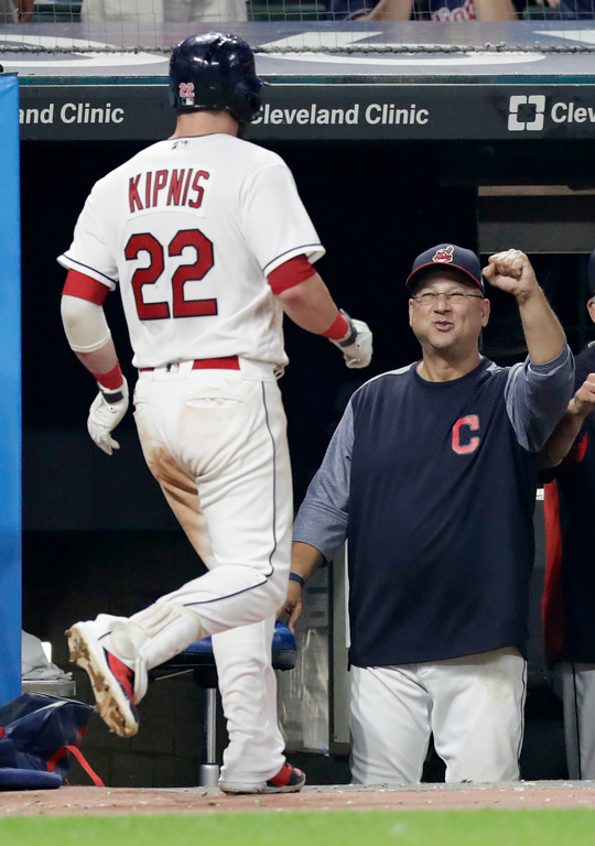 . Cleveland Indians manager Terry Francona, right, congratulates Jason Kipnis after Kipnis hit a solo home run in the sixth inning of a baseball game against the Minnesota Twins, Monday, Aug. 6, 2018, in Cleveland. (AP Photo/Tony Dejak)