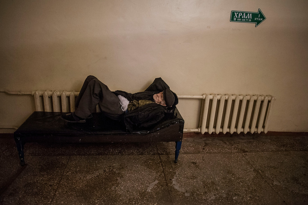 . An elderly Ukrainian man lies on a bed, in the basement of a hospital hit by the Ukrainian Army Artillery, at the Hospital N� 3 for elder people and children in Donetsk, Ukraine. Monday, Jan. 19, 2015. The separatist stronghold, Donetsk, was shaken by intense outgoing and incoming artillery fire on Sunday as a bitter battle raged for control over the city\'s airport. Streets in the city, which was home to 1 million people before unrest erupted in spring, were completely deserted and the windows of apartments in the center rattled from incessant rocket and mortar fire.  (AP Photo/Manu Brabo)