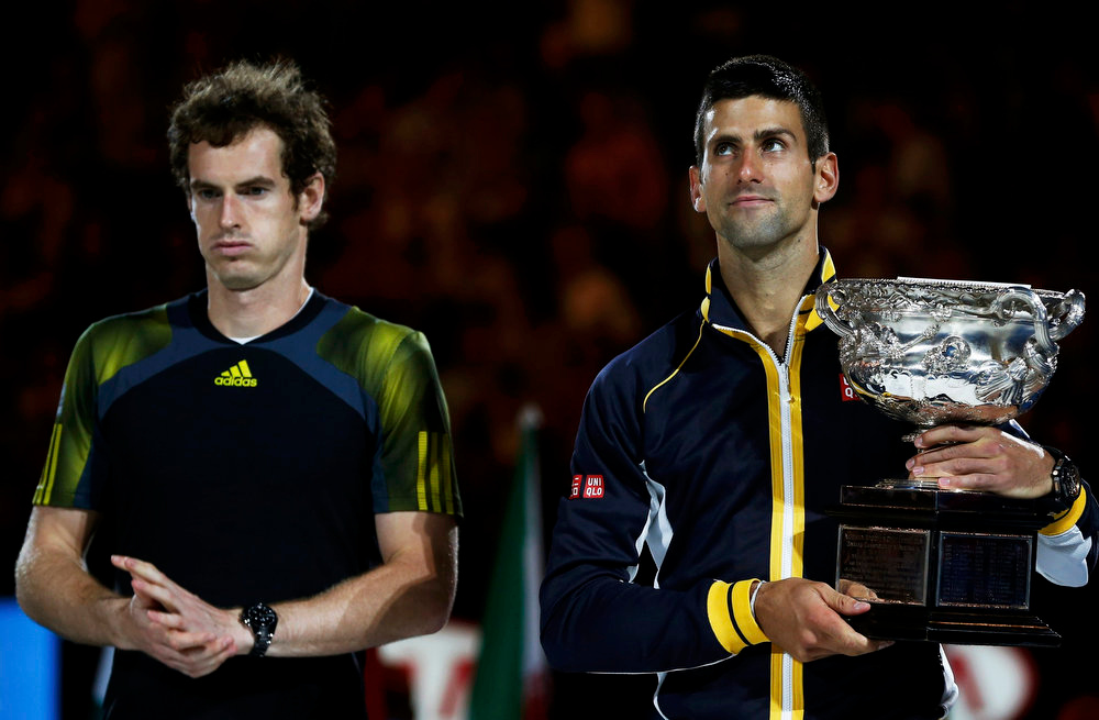 . Novak Djokovic of Serbia (R) poses with the Norman Brookes Challenge Cup next to runner-up Andy Murray of Britain after their men\'s singles final match at the Australian Open tennis tournament in Melbourne January 27, 2013.  REUTERS/Damir Sagolj