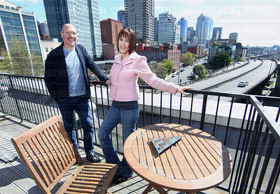 Ben and Meloday Paxton say their condo trembles when heavy and fast moving traffic speed past their home adjacent to the Alaskan Way Viaduct in Seattle, WA
