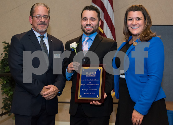 11/16/17 Wesley Bunnell | Staff The Greater New Britain Chamber of Commerce covering New Britain and Berlin held their annual dinner Thursday evening at CCSU celebrating 104 years. President Tim Stewart, L, stands with Owner of MofonGo Restaurant Vincent Placeres as the restaurant received the Winged Victory Downtown Award along with Mayor Erin Stewart.