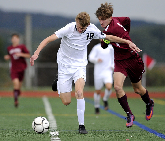 10/17/2018 Mike Orazzi   Staff Newington's Erik Kozikowski (18) and Bristol Central's David Bowes (8) during boys soccer at BC Wednesday afternoon.
