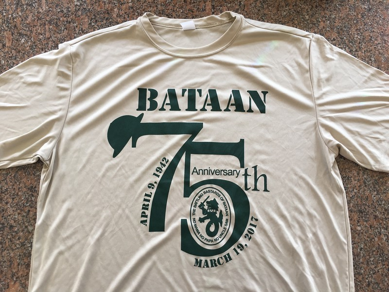 """The t-shirt provided to all participants, plus a paper certificate and a memento """"dog tag."""""""