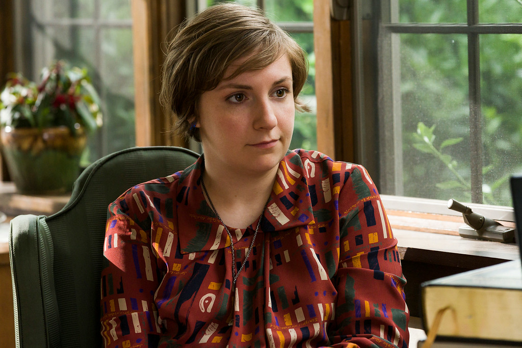 """. This image released by HBO shows Lena Dunham in a scene from \""""Girls.\"""" Dunham was nominated for an Emmy Award for best actress in a comedy series on Thursday, July 10, 2014. The 66th Primetime Emmy Awards will be presented Aug. 25 at the Nokia Theatre in Los Angeles. (AP Photo/HBO, Mark Schafer)"""