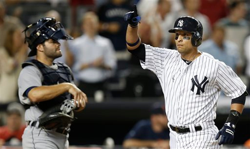 . Detroit Tigers catcher Alex Avila, left, watches as New York Yankees Martin Prado crosses the plate after hitting a fifth-inning solo home run in a baseball game at Yankee Stadium in New York, Tuesday, Aug. 5, 2014.  (AP Photo/Kathy Willens)