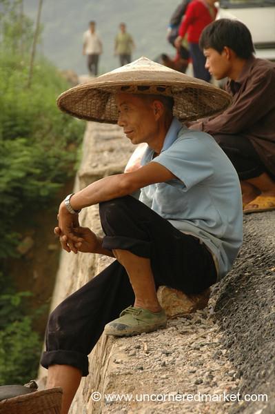 Man Looks Over River - Guizhou Province, China