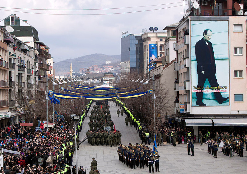 . A Kosovo Security Force honor guard leads the parade in the center of Pristina marking the 5th anniversary since Kosovo seceded from Serbia Sunday, Feb. 17, 2013. Serbia rejects Kosovo\'s independence. Banner on wall at right shows the late Kosovo leader Ibrahim Rugova. (AP Photo/Visar Kryeziu)