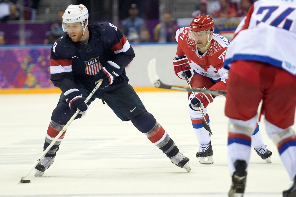. Joe Pavelski (8) of the U.S.A. brings the puck up the ice as Alexei Tereshenko (27) of the Russia pursues during  the third period of the U.S.A.\'s win at Bolshoy arena. Sochi 2014 Winter Olympics on Saturday, February 15, 2014. (Photo by AAron Ontiveroz/The Denver Post)