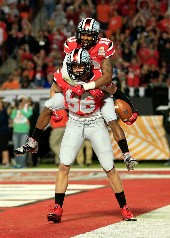 . MIAMI GARDENS, FL - JANUARY 03: Jeff Heuerman #86 and Philly Brown #10 of the Ohio State Buckeyes celebrate after a touchdown by Heuerman in the second quarter against the Clemson Tigers during the Discover Orange Bowl at Sun Life Stadium on January 3, 2014 in Miami Gardens, Florida.  (Photo by Chris Trotman/Getty Images)
