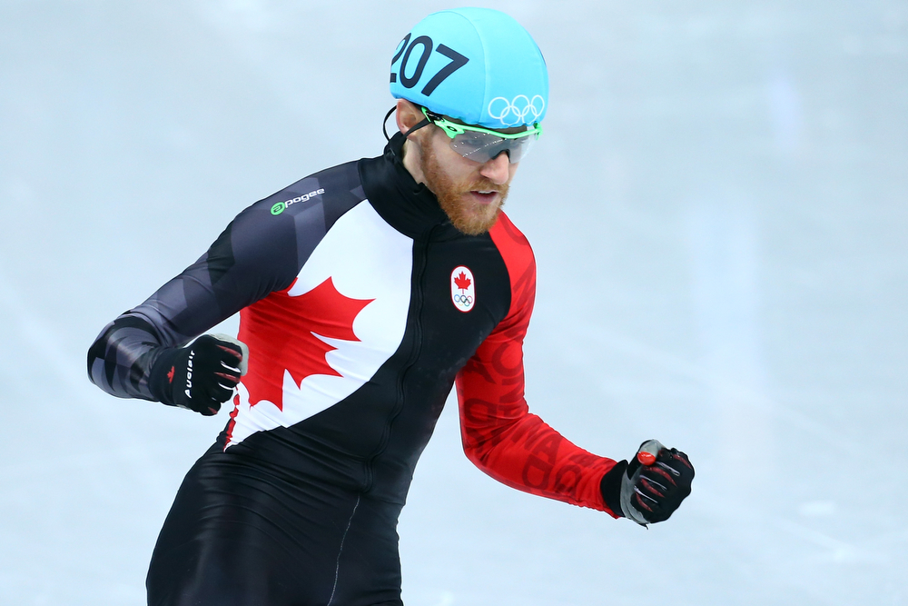 . Olivier Jean of Canada reacts after competing in the Short Track Men\'s 500m Heat at Iceberg Skating Palace on day 11 of the 2014 Sochi Winter Olympics on February 18, 2014 in Sochi, Russia.  (Photo by Streeter Lecka/Getty Images)