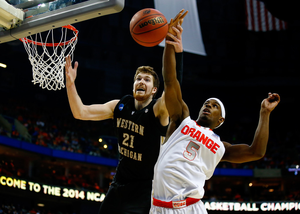 . BUFFALO, NY - MARCH 20: Shayne Whittington #21 of the Western Michigan Broncos and C.J. Fair #5 of the Syracuse Orange battle for a rebound during the second round of the 2014 NCAA Men\'s Basketball Tournament at the First Niagara Center on March 20, 2014 in Buffalo, New York.  (Photo by Jared Wickerham/Getty Images)