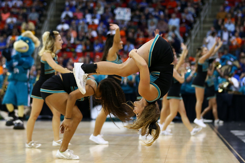 . The Coastal Carolina Chanticleers cheerleaders perform in the first half against the Virginia Cavaliers during the Second Round of the 2014 NCAA Basketball Tournament at PNC Arena on March 21, 2014 in Raleigh, North Carolina.  (Photo by Streeter Lecka/Getty Images)