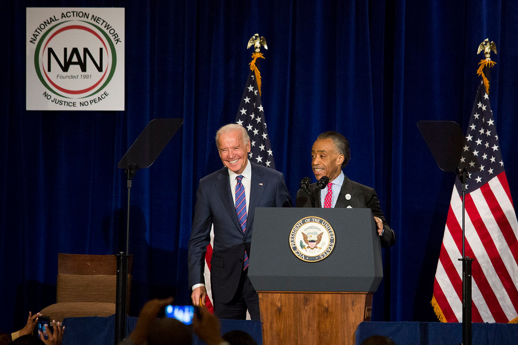 . WASHINGTON, DC - JANUARY 20:  Rev. Al Sharpton (R) introduces U.S. Vice President Joe Biden before speaking during the National Action Network\'s annual King Day Breakfast, at The Mayflower Hotel, January 20, 2014 in Washington, DC. On Monday, Americans honor the birth of civil rights leader Martin Luther King, Jr. (Drew Angerer/Getty Images)