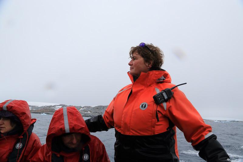 Antarctica - Jan 2013 - Sergey Vavilov Circle Trip, The One Ocean Expedition staff:   Liz Calhoun, navigating the Zodiac... a great experience.