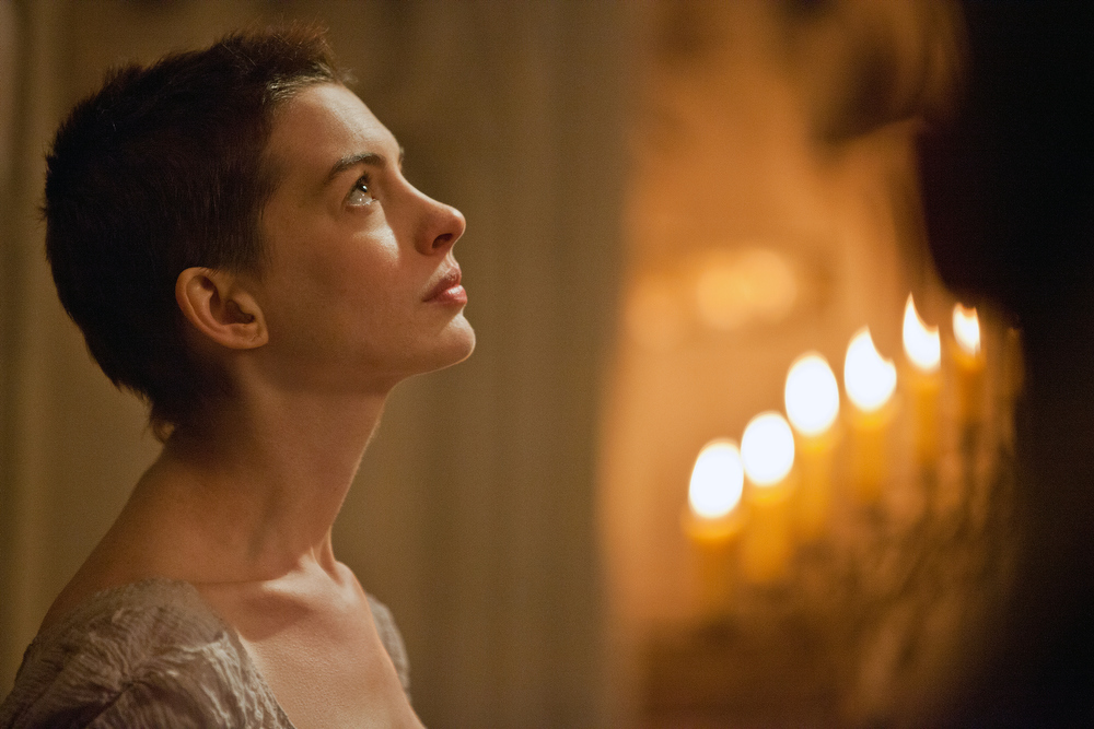 ". This film image released by Universal Pictures shows actress Anne Hathaway portraying Fantine, a struggling, sickly mother forced into prostitution in 1800s Paris, in a scene from the screen adaptation of ""Les Miserables.\""  Hathaway was nominated Thursday, Dec. 13, 2012 for a Golden Globe for best supporting actress for her role in ìLes Miserables.ì  The 70th annual Golden Globe Awards will be held on Jan. 13. (AP Photo/Universal Pictures, Laurie Sparham)"