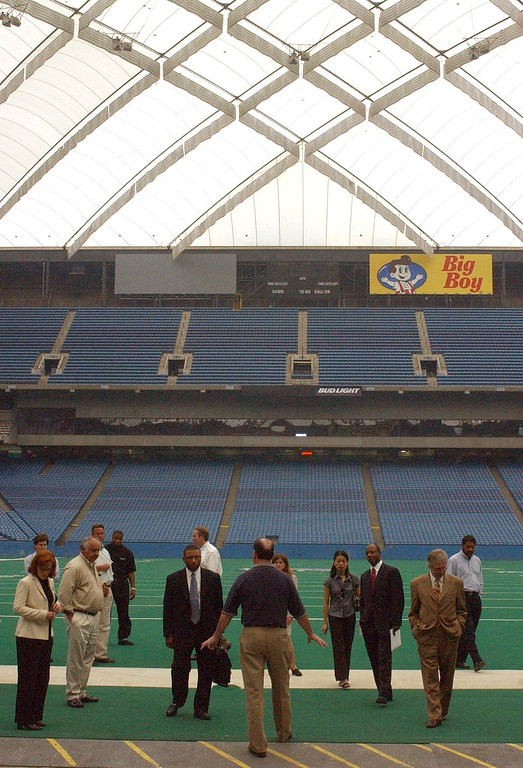 . John Kissick, center, director of operations at the Pontiac Silverdome leads a group during a walking tour of the faculity on Monday. The city of Pontiac and Pontiac Silverdome officals are soliciting offers for the property, since the Detroit Lions vacated the property for their new $315 million indoor venue located in down town Detroit.