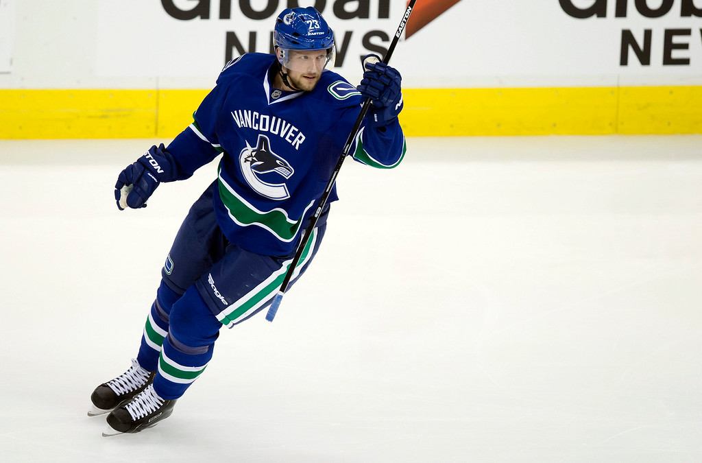 . Vancouver Canucks\' Alexander Edler, of Sweden, celebrates his goal against the Detroit Red Wings during the second period of an NHL hockey game in Vancouver, British Columbia on Saturday, Jan. 3, 2015. (AP Photo/The Canadian Press, Darryl Dyck)
