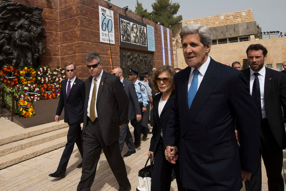 Description of . U.S. Secretary of State John Kerry (2nd R) and his wife Teresa leave after a wreath-laying ceremony marking Israel\'s annual day of Holocaust remembrance, at Yad Vashem in Jerusalem on April 8, 2013. Israel on Monday commemorates the six million Jews killed by the Nazis in the Holocaust during World War Two. REUTERS/Ronen Zvulun