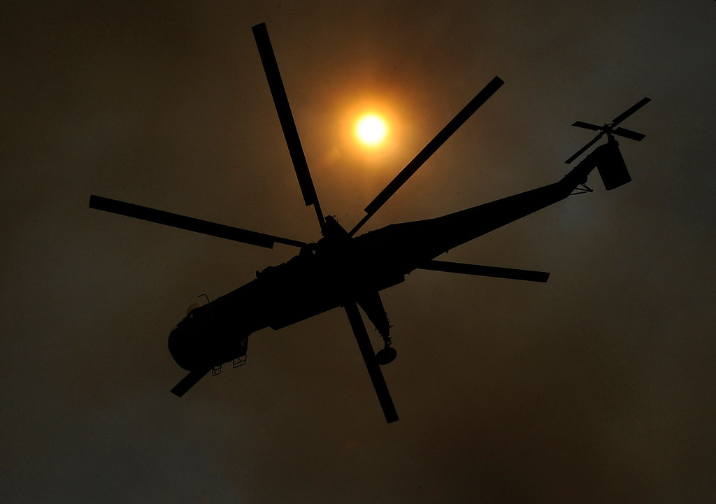. A sky crane helicopter makes a water drop during the second day of the Springs Fire in the mountain areas of Ventura County CA.  May 3, 2013. A fierce, wind-whipped brush fire spread on Friday along the California coast northwest of Los Angeles, threatening several thousand homes and a military base as more than 1,100 dwellings were ordered evacuated and a university campus was closed. May 2,2013. Ventura County California.  Photo by Gene Blevins/LA Daily News