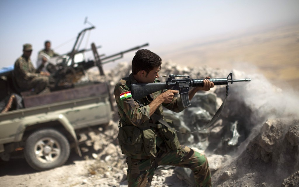 . An Iraqi Kurdish Peshmerga fighter fires at Islamic-State (IS) militant positions, from his position on the top of Mount Zardak, a strategic point taken 3 days ago, about 25  kilometres east of Mosul on September 9,2014. Kurdish forces in the north have been bolstered by US strikes and took control of Mount Zardak, a strategic site that provides a commanding view of the surrounding area, a senior US officer said. JM LOPEZ/AFP/Getty Images