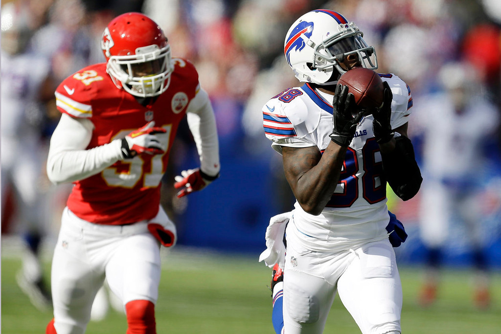 . Buffalo Bills wide receiver Marquise Goodwin (88) hauls in a pass as Kansas City Chiefs cornerback Marcus Cooper (31) attempts to defend on the 59-yard touchdown run during the first quarter of an NFL football game in Orchard Park, N.Y., Sunday, Nov. 3, 2013. (AP Photo/Gary Wiepert)