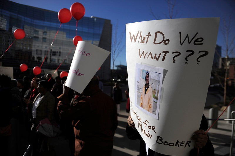 . People gather in support during a rally seeking justice for Marvin Lewis Booker, who was killed during an altercation with deputies while being booked on charges of possession of drug paraphernalia in 2010. Denver Detention Center on Wednesday, March 12, 2014. (Photo By AAron Ontiveroz/ The Denver Post)