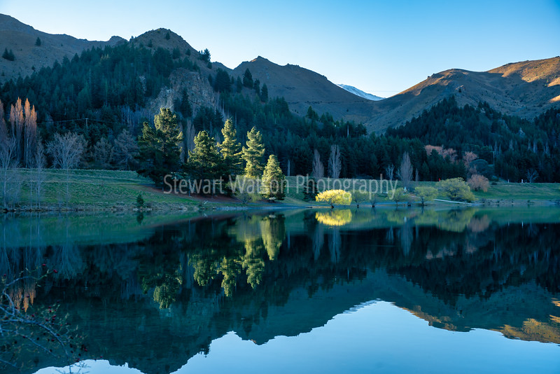 The stunning reflections and scenery in the grounds of Lake Benmore Power station inNew Zealand