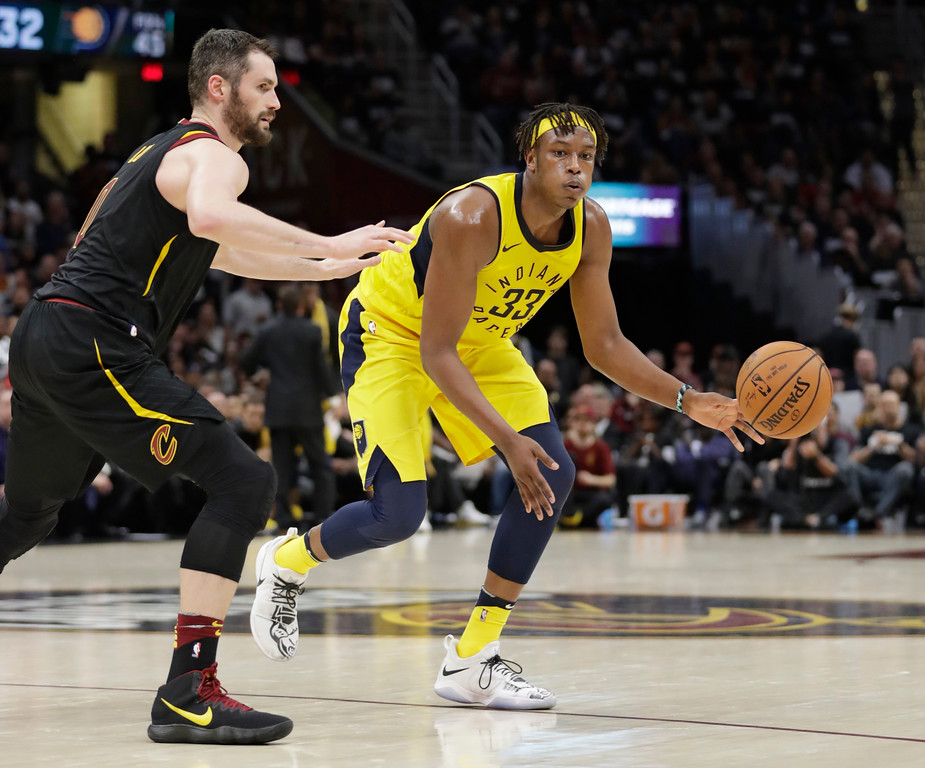 . Indiana Pacers\' Myles Turner (33) passes against Cleveland Cavaliers\' Kevin Love (0) in the second half of Game 1 of an NBA basketball first-round playoff series, Sunday, April 15, 2018, in Cleveland. (AP Photo/Tony Dejak)