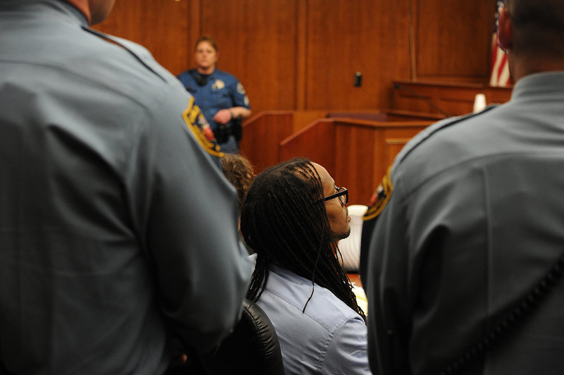 . Convicted killer Nathan Dunlap sits in the court room as Judge William Sylvester tells the court that he has set a date for his execution.   Judge William Sylvester set an execution date for Dunlap for the week of August 18th-24th, 2013. The hearing held today was to  set a date for the execution of convicted murderer Nathan Dunlap at the Arapahoe County Court in Division court room 408  in Centennial, CO on May 1, 2013.   Judge William Sylvester is the presiding judge on the case.  (Photo by Helen H. Richardson/The Denver Post)