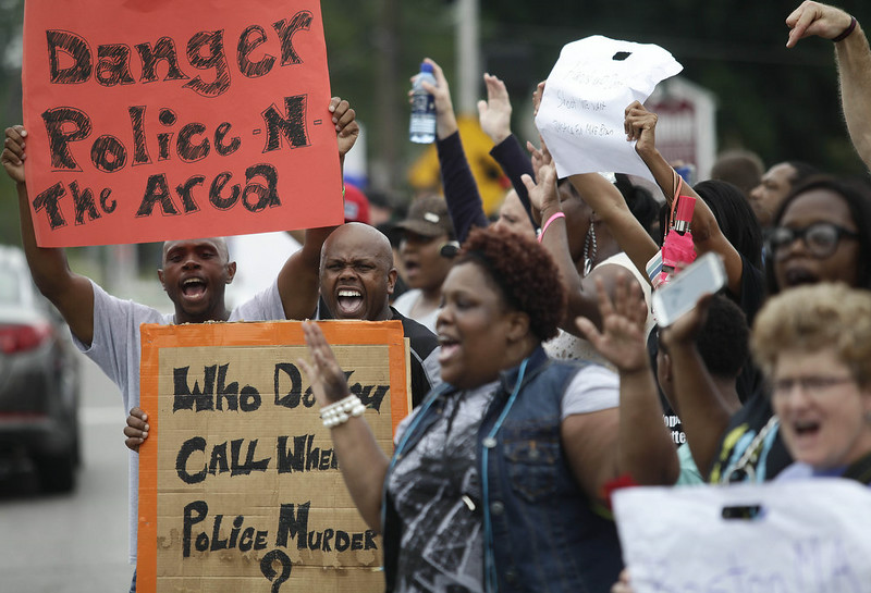 . Demonstrators protest Michael Brown\'s murder with their hands in the air August 17, 2014 in Ferguson, Missouri.Tensions still run high in the Ferguson community after 18 -year-old Michael Brown was killed by a Ferguson Police Officer August 9 on Canfield Drive. (Photo by Joshua Lott/Getty Images)