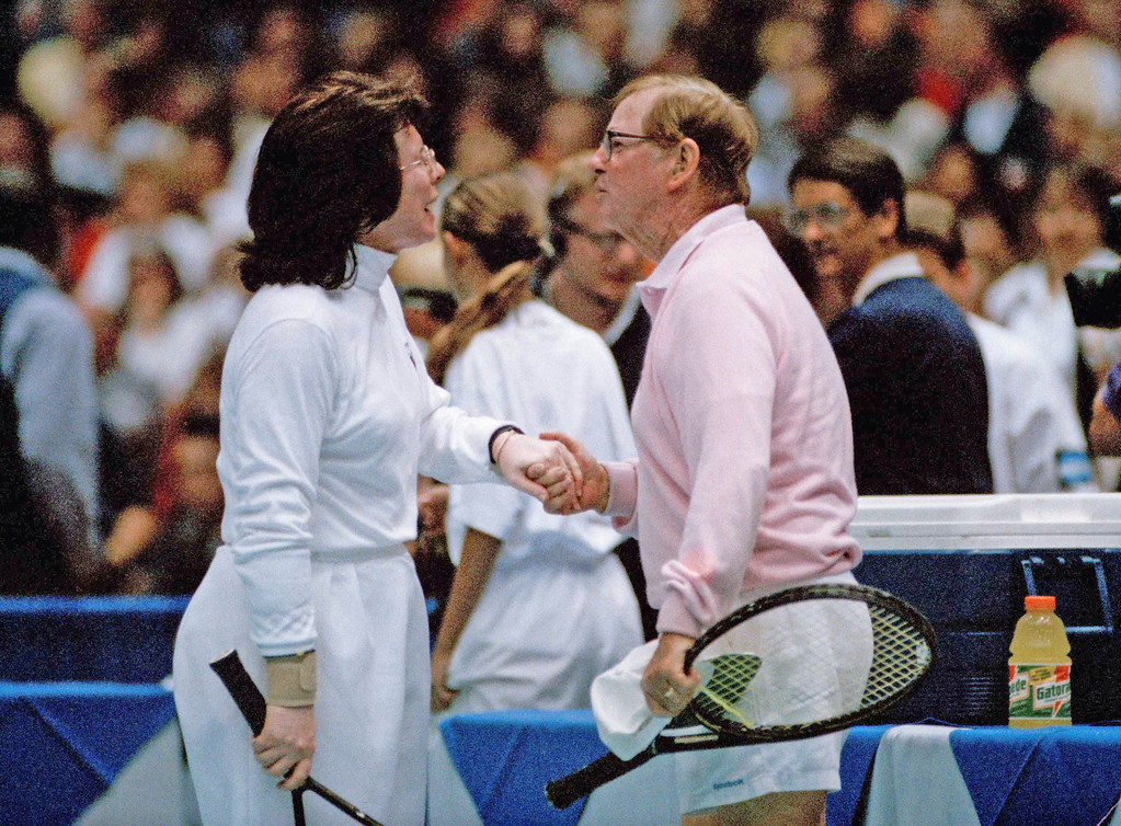 . Billie Jean King greets opponent Bobby Riggs after their celebrity tennis match at the Forum in Los Angeles on Sep 20, 1993. King and her partner, Elton John, beat Riggs and Martina Navratilova 3-2 in a 15 minute match, which raised money for AIDS education and patient care. The 20th anniversary of the famed Astrodome battle of the sexes match between King and Riggs, now 75, was Monday Sept. 20. (AP Photo/Mark J. Terrill)