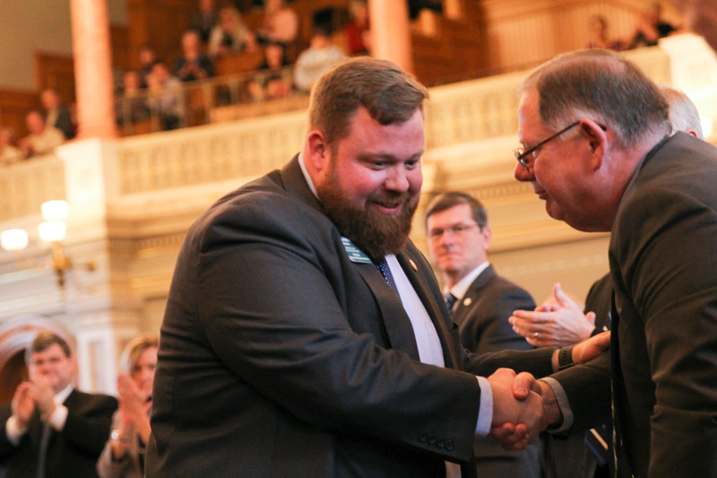 Incoming Speaker Pro Tem Rep. Blaine Finch is congratulated by incoming majority leader Rep. Dan Hawkins