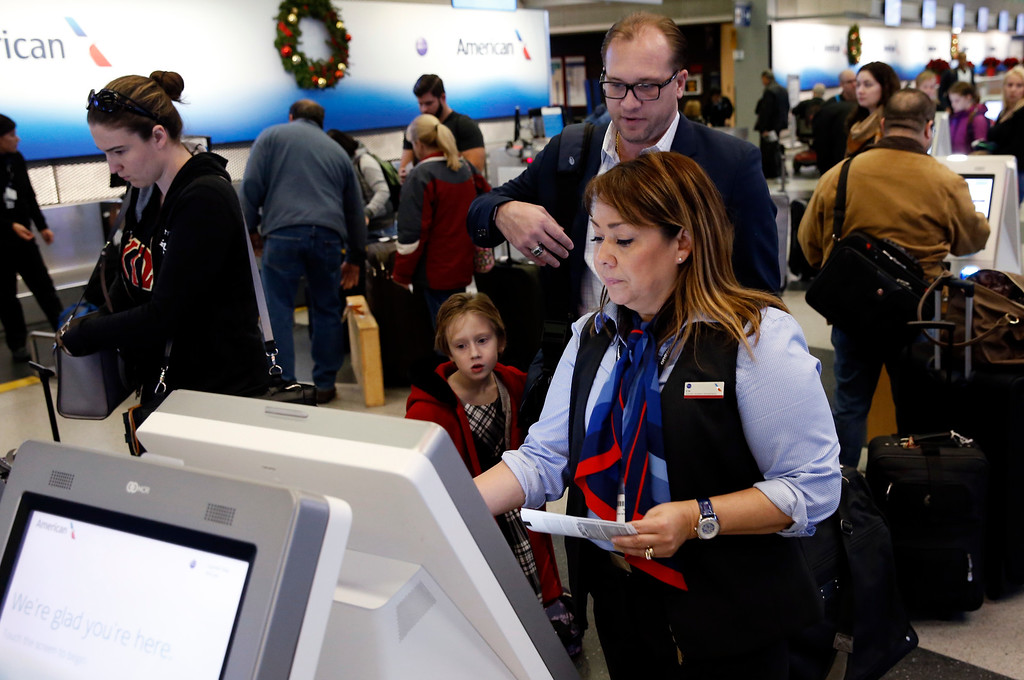 . Travelers check in at the American Airlines ticket counter at O\'Hare International Airport in Chicago, Wednesday, Nov. 23, 2016. Almost 49 million people are expected to travel 50 miles or more for the Thanksgiving holiday, the most since 2007, according to AAA. (AP Photo/Nam Y. Huh)