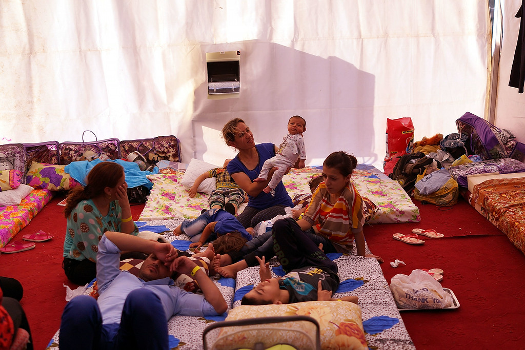 . ERBIL, IRAQ - JUNE 27:  An Iraqi Christian family live in a tent at a displacement camp for Christians after having to flee their district on June 26, 2014 in Erbil, Iraq.Tens of thousands of people have fled Iraq\'s second largest city of Mosul after it was overrun by ISIS (Islamic State of Iraq and Syria) militants. Many have been temporarily housed at various IDP  camps around the region including the area close to Erbil, as they hope to enter the safety of the nearby Kurdish region. Christians, Shiites and Kurdish Iraqis have received the brunt of the violence from the militants.  (Photo by Spencer Platt/Getty Images)
