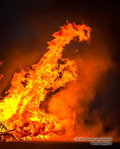 The flames create an eery dragon.