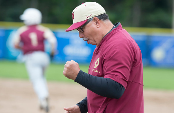 05/29/19 Wesley Bunnell | Staff Southington defeated New Britain 4-3 in 11 innings on a walk off single by Billy Carr (17) in the continuation of a game suspended in the 10th inning due to rain on May 29th. New Britain assistant coach Gerry Berthiaume reacts after a home run by Danniel Rivera (1) gave New Britain the lead.