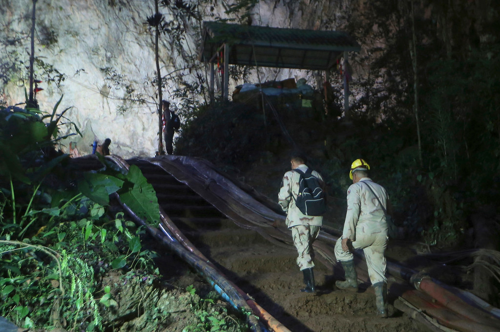 . Rescuers make their way up at the entrance to a cave complex where 12 boys and their soccer coach went missing, in Mae Sai, Chiang Rai province, in northern Thailand, Monday, July 2, 2018. Rescue divers are advancing in the main passageway inside the flooded cave in northern Thailand where the boys and their coach have been missing more than a week. (AP Photo/Sakchai Lalit)