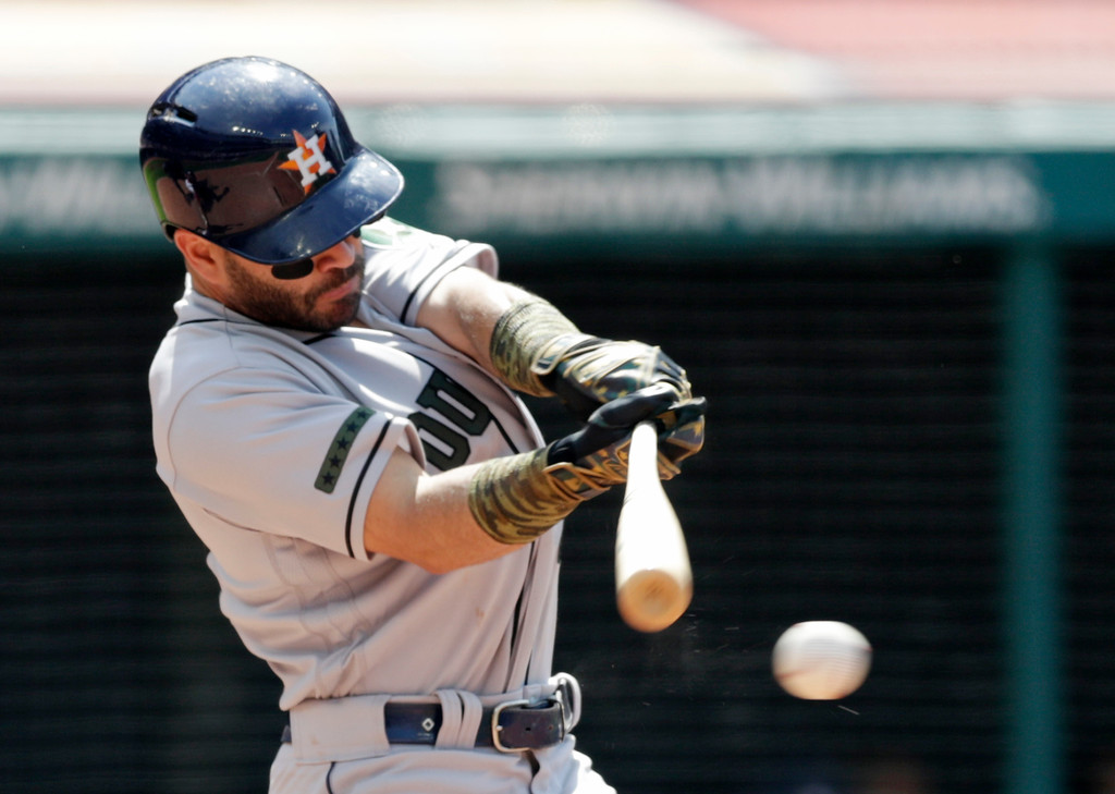 . Houston Astros\' Jose Altuve hits an RBI-single off Cleveland Cavaliers relief pitcher Evan Marshall in the eighth inning of a baseball game, Sunday, May 27, 2018, in Cleveland. George Springer scored on the play. (AP Photo/Tony Dejak)