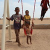 Saed (2) on the swing, behind him is Ma'na' (boy) and Alofa (10). At the next swing is Dawood (with the red shirt).