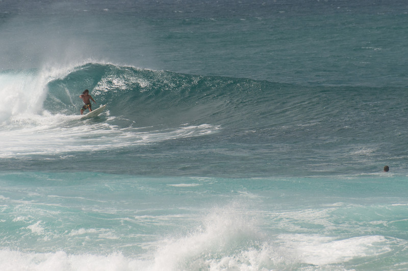 Surfer riding the wave in Oahu, Hawaii