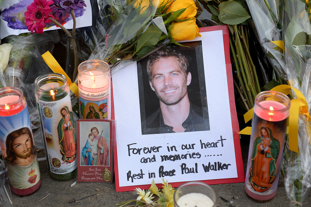 . A memorial for Paul Walker and Roger Rodas, Sunday, December 1, 2013, at the scene of their fatal crash site on Hercules Street near Kelly Johnson Parkway in Valencia. (Photo by Michael Owen Baker/L.A. Daily News)