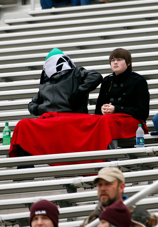 . Football fans bundle themselves in layers of blankets and winter wear in order to watch the Independence Bowl NCAA college football game featuring Ohio and Louisiana-Monroe in Shreveport, La., Friday, Dec. 28, 2012. (AP Photo/Rogelio V. Solis)