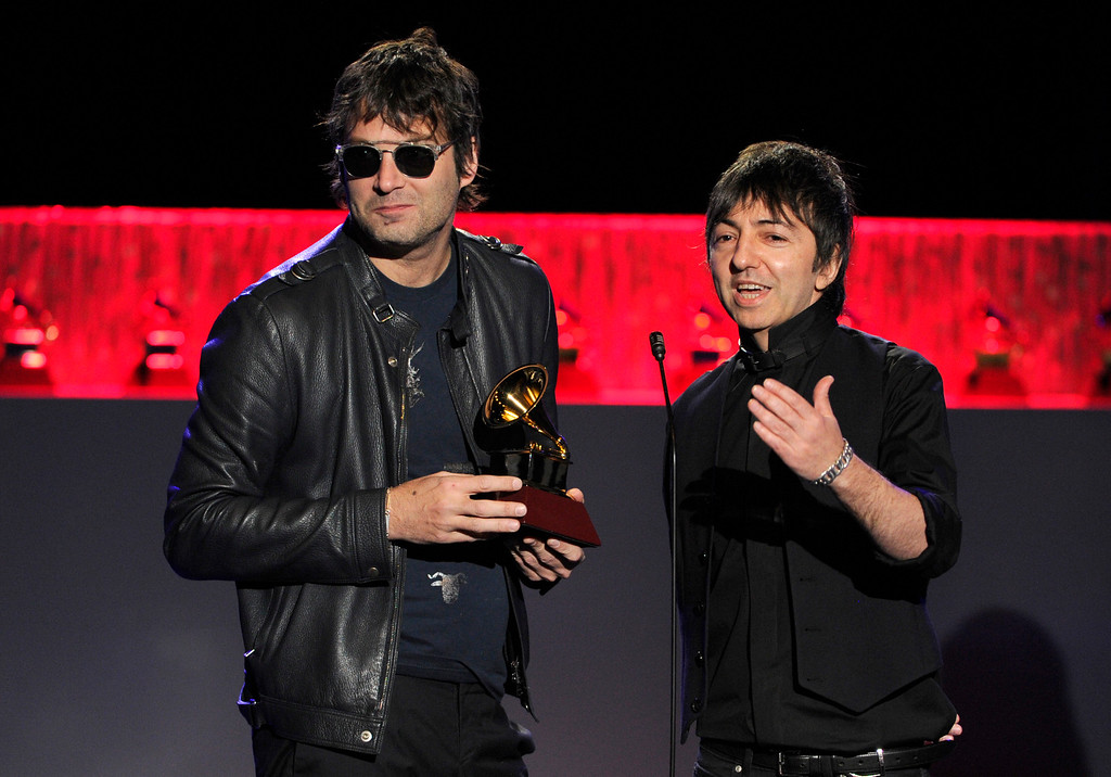 """. Mariano \'Roger\' Dominguez, left, and Adrian Dargelos, of the musical group Babasonicos, accept the award for best alternative music album for \""""Romantisismico\"""" on stage at the 15th annual Latin Grammy Awards at the MGM Grand Garden Arena on Thursday, Nov. 20, 2014, in Las Vegas. (Photo by Chris Pizzello/Invision/AP)"""