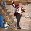JoAnn Follette begins to explore the basement of the barn.  Notice the size of the overhead timbers and the stone wall.