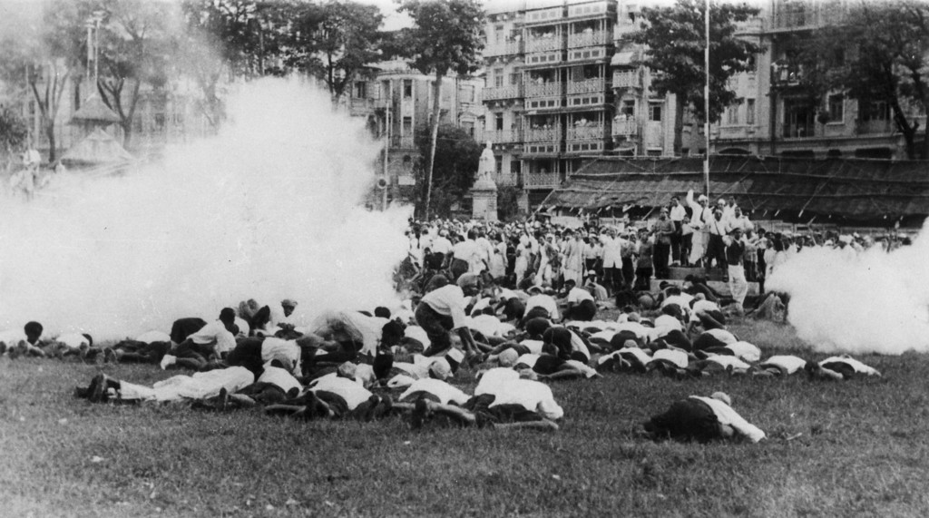 . Demonstrators lying on the ground to avoid clouds of tear gas released by the police when they refused to disperse after protesting against the arrest of Gandhi and other National Congress leaders, 10th August 1942.  (Photo by Keystone/Getty Images)